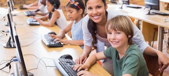 38077929 - cute pupils in computer class with teacher at the elementary school